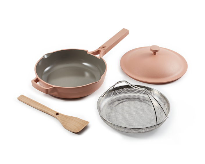 """And speaking of <a href=""""https://www.architecturaldigest.com/story/best-cookware-quality-affordable-sources?mbid=synd_yahoo_rss"""" rel=""""nofollow noopener"""" target=""""_blank"""" data-ylk=""""slk:kitchenware"""" class=""""link rapid-noclick-resp"""">kitchenware</a> that does it all, you guys <em>really</em> loved the Always Pan from Our Place this year, making it one of the top products purchased in 2020. This thoughtfully designed nontoxic ceramic pan is said to replace eight pieces of cookware, and you were willing to make that bet. From the built-in spatula rest to the palatable color palette, this standout pan is also a smart investment for a <a href=""""https://www.architecturaldigest.com/story/small-kitchen-design-ideas?mbid=synd_yahoo_rss"""" rel=""""nofollow noopener"""" target=""""_blank"""" data-ylk=""""slk:small kitchen"""" class=""""link rapid-noclick-resp"""">small kitchen</a> with limited storage. When you have to look at your cookware a lot, buying a few attractive pieces rather than stocking up on a bulky set makes complete sense. Their <a href=""""https://fave.co/2Kxk2mD"""" rel=""""nofollow noopener"""" target=""""_blank"""" data-ylk=""""slk:steamer baskets"""" class=""""link rapid-noclick-resp"""">steamer baskets</a> made it to the top of the list, too. $145, Our Place. <a href=""""https://fromourplace.com/products/always-essential-cooking-pan"""" rel=""""nofollow noopener"""" target=""""_blank"""" data-ylk=""""slk:Get it now!"""" class=""""link rapid-noclick-resp"""">Get it now!</a>"""