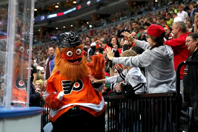 "PRAGUE, CZECH REPUBLIC - OCTOBER 04: The Philadelphia Flyers mascot ""Gritty"" interacts with fans in the third period against the Chicago Blackhawks during the NHL Global Series Challenge 2019 match at O2 Arena on October 4, 2019 in Prague, Czech Republic. (Photo by Chase Agnello-Dean/NHLI via Getty Images)"