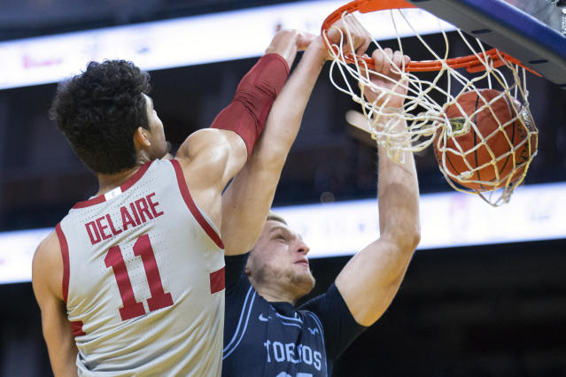 San Diego forward Yauhen Massalski (25) dunks in front of Stanford forward Jaiden Delaire (11) during the first half of an NCAA college basketball game on Saturday, Dec. 21, 2019, in San Francisco. (AP Photo/D. Ross Cameron)