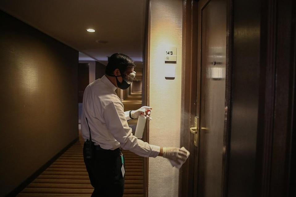 A hotel employee disinfects one of the rooms at the Concorde Hotel in Shah Alam June 9, 2020. — Picture by Yusof Mat Isa