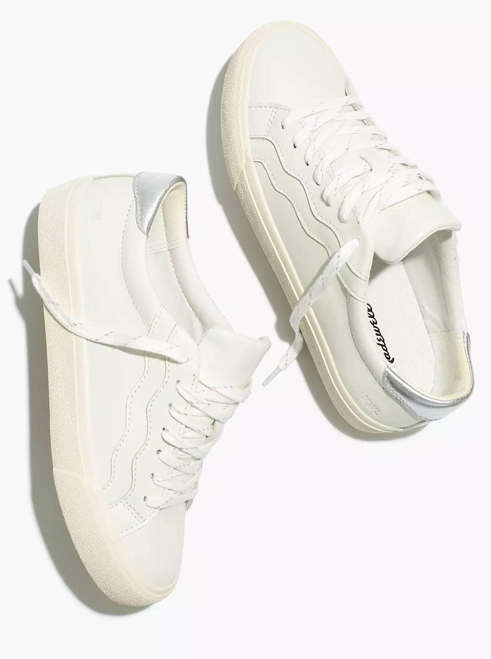 """White sneakers are on the list of <a href=""""https://www.glamour.com/gallery/10-wardrobe-essentials-every-woman-should-own?mbid=synd_yahoo_rss"""" rel=""""nofollow noopener"""" target=""""_blank"""" data-ylk=""""slk:wardrobe essentials"""" class=""""link rapid-noclick-resp"""">wardrobe essentials</a> everyone should own, but we especially like this pair for the playful squiggles along the profile. $88, Madewell. <a href=""""https://www.madewell.com/sidewalk-low-top-sneakers-in-leather-wave-edition-MC711.html?"""" rel=""""nofollow noopener"""" target=""""_blank"""" data-ylk=""""slk:Get it now!"""" class=""""link rapid-noclick-resp"""">Get it now!</a>"""