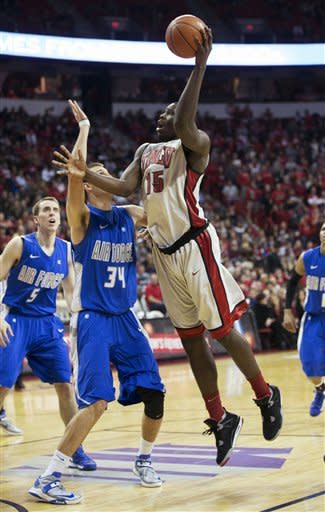 UNLV forward Anthony Bennett (15) takes a shot while being guarded by Air Force center Taylor Broekhuis (34) during the first period of an NCAA college basketball game, Saturday, Jan. 12, 2013, in Las Vegas. (AP Photo/Eric Jamison)