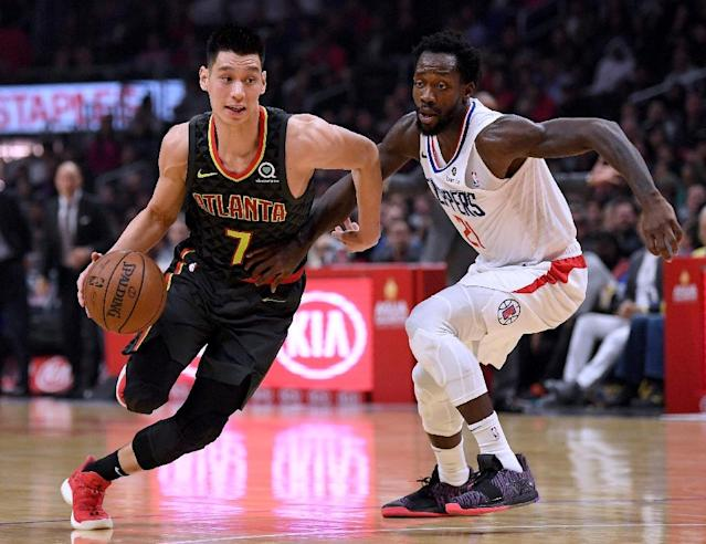 Jeremy Lin of Atlanta, driving with the ball past Patrick Beverley of the Los Angeles Clippers, is reportedly finalizing a contract buyout with the Hawks so he can join the Toronto Raptors (AFP Photo/Harry How)