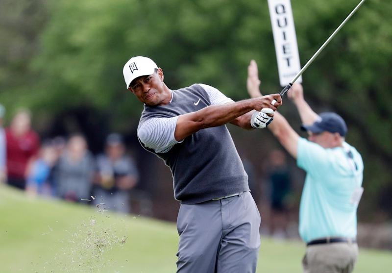 Woods and McIlroy win in Match Play, set up Saturday meeting