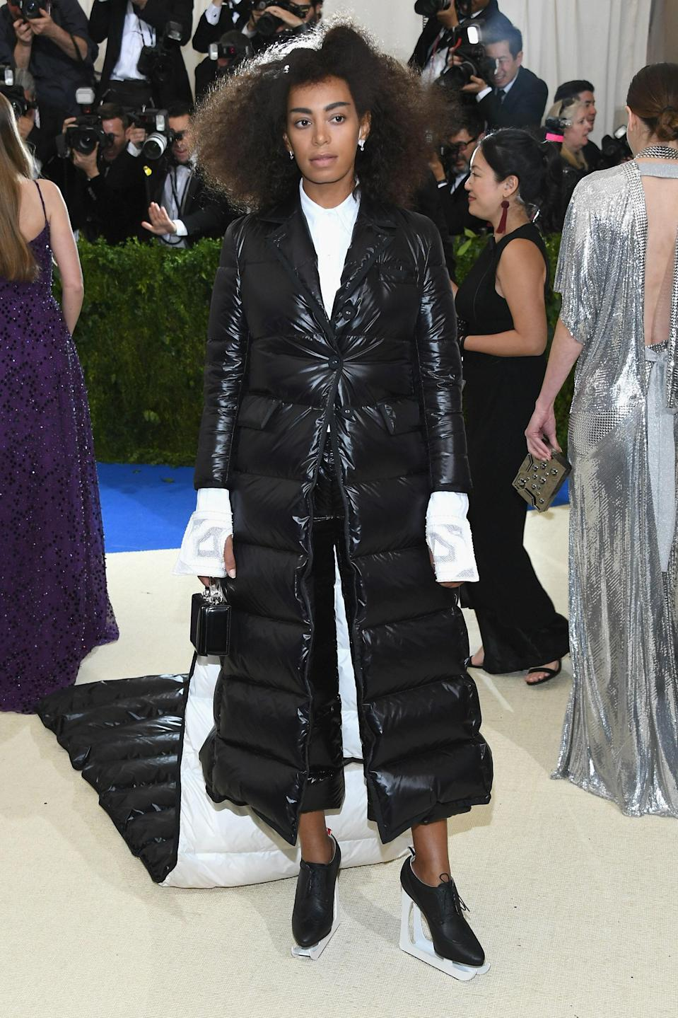 """<h1 class=""""title"""">Solange Knowles in Thom Browne, Bulgari jewelry and with a Mark Cross bag</h1> <cite class=""""credit"""">Photo: Getty Images</cite>"""