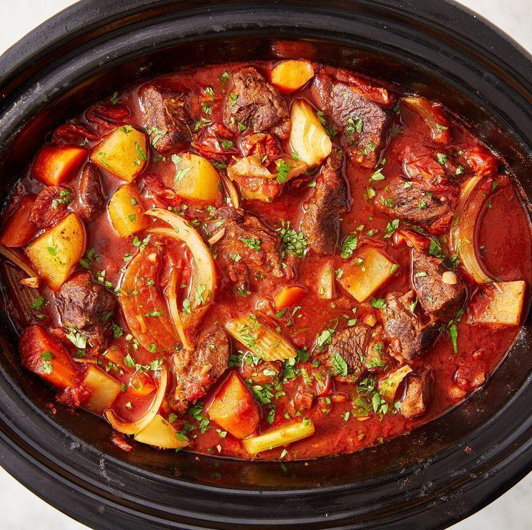 """<p>If you need an excuse to get your slow cooker out, this is it! Let everything cook together for hours for the deepest, most satisfying beef stew you'll try. Don't skip searing the beef — it creates more deeply flavoured meat that develops the flavour of the stew even further. </p><p>Get the <a href=""""https://www.delish.com/uk/cooking/recipes/a28830324/slow-cooker-red-wine-beef-stew-recipe/"""" rel=""""nofollow noopener"""" target=""""_blank"""" data-ylk=""""slk:Slow Cooker Red Wine Beef Stew"""" class=""""link rapid-noclick-resp"""">Slow Cooker Red Wine Beef Stew</a> recipe.</p>"""