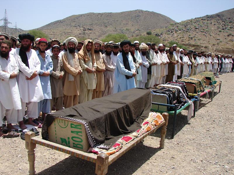 FILE - In this Thursday, June 16, 2011 file photo, Pakistani villagers offer funeral prayers for people who were reportedly killed by a U.S. drone attack in Miranshah, capital of Pakistani tribal region of North Waziristan along the Afghanistan border. American drone strikes inside Pakistan are killing far fewer civilians than many in the country are led to believe, according to a rare on-the-ground investigation by The Associated Press of 10 of the deadliest attacks in the past 18 months. (AP Photo/Hasbunullah)