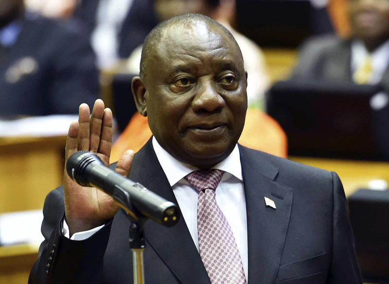 In this photo supplied by the South African Government Communications and Information Services (GCIS) Cyril Ramaphosa is sworn in as a member of parliament in Cape Town, South Africa, Wednesday, May 22, 2019. Ramaphosa has taken steps to crack down on corruption Wednesday as the country's new parliament voted him to lead the country for a five-year term. (Jairus Mmufle/Government Communications and Information Services via AP)