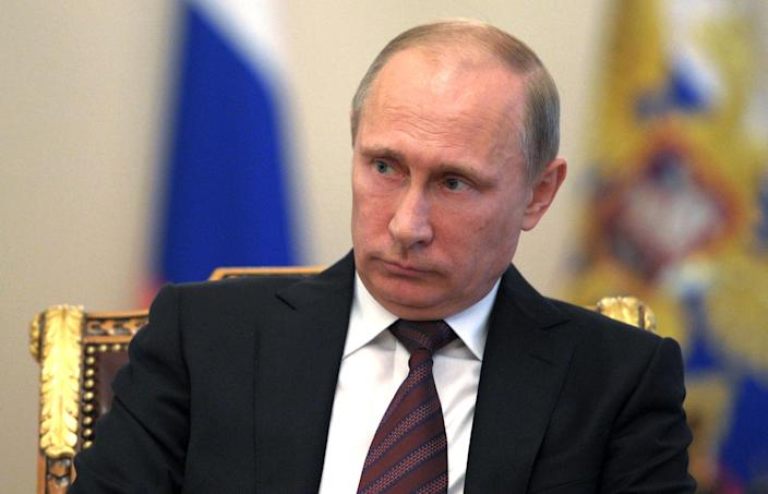 Russian President Vladimir Putin, listens during a meeting with Russian Parliament speakers at the Novo-Ogaryovo residence outside Moscow, Russia, on Monday, Sept. 2, 2013. President Vladimir Putin hopes to send a delegation of Russian lawmakers to the United States to discuss the situation in Syria with members of Congress, the Interfax news agency reported Monday. (AP Photo/RIA-Novosti, Alexei Druzhinin, Presidential Press Service)
