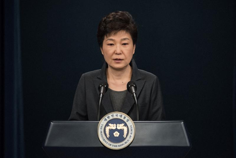 South Korea's Parliament voted on December 9, 2016 to impeach President Park Geun-Hye over a corruption scandal (AFP Photo/Ed Jones)