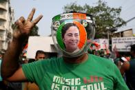 A supporter of the Chief Minister of West Bengal state and the Chief of Trinamool Congress (TMC) Mamata Banerjee gestures, in Kolkata