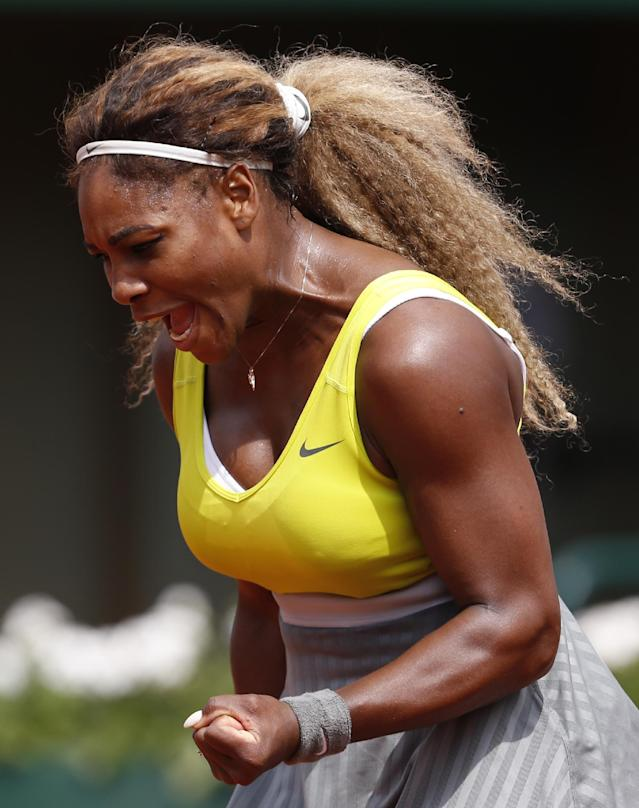 Serena Williams of the U.S, reacts shortly before defeating France's Alize Lim during the first round match of the French Open tennis tournament at the Roland Garros stadium, in Paris, France, Sunday, May 25, 2014. Williams won 6-2, 6-1. (AP Photo/Darko Vojinovic)