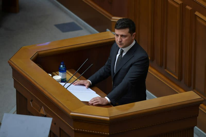 FILE PHOTO: Ukrainian President Volodymyr Zelenskiy attends a parliamentary session in Kyiv