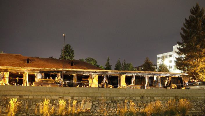 A burned out makeshift hospital stands after a fire in North Macedonia's northwestern city of Tetovo, early Thursday, Sept. 9, 2021. The blaze occurred late Wednesday at the makeshift hospital for COVID-19 patients. (AP Photo/Boris Grdanoski)