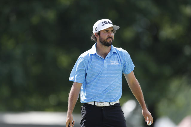 Mark Hubbard walks off the 11th green during the third round of the Rocket Mortgage Classic golf tournament, Saturday, July 4, 2020, at the Detroit Golf Club in Detroit. (AP Photo/Carlos Osorio)