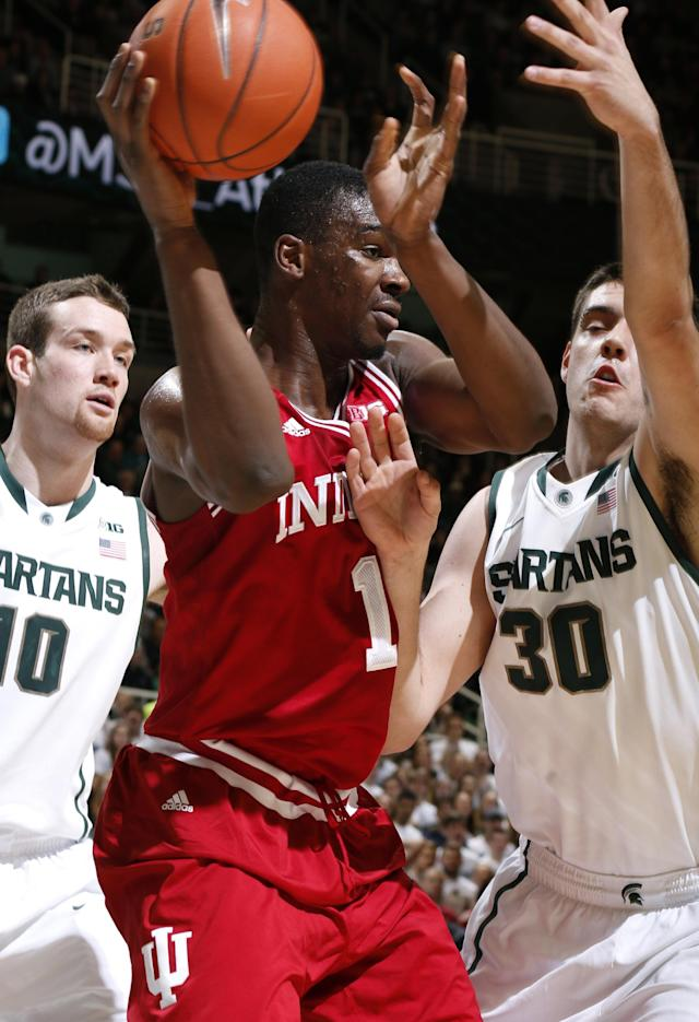 Indiana's Noah Vonleh (1) is pressure by Michigan State's Kenny Kaminski (30) and Matt Costello, left, during the first half of an NCAA college basketball game, Tuesday, Jan. 21, 2014, in East Lansing, Mich. (AP Photo/Al Goldis)