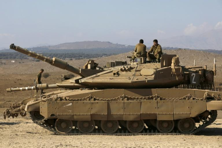 Israeli soldiers set up a tank near Kibutz Merom in the Israeli-annexed Golan Heights on the border with Syria on September 9, 2019 (AFP Photo/JALAA MAREY)