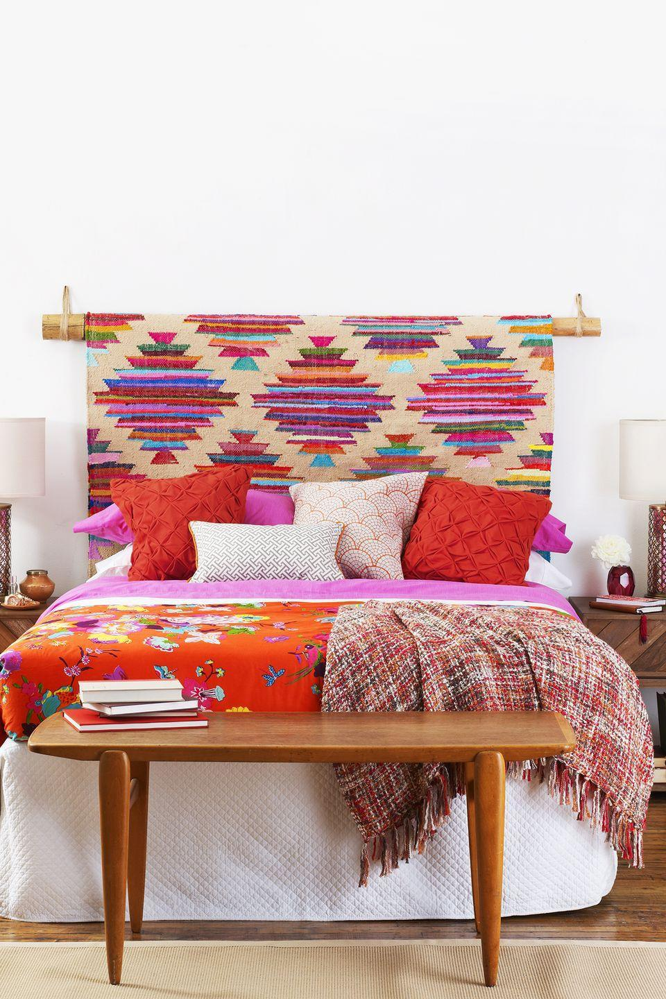 <p>Hang a patterned rug or tapestry on a sturdy bamboo pole for a customizable backdrop. Then identify a color to use as an accent throughout the rest of your space. </p>