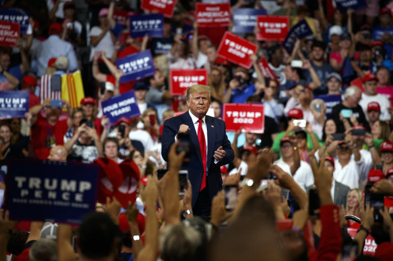 President Donald Trump pumps his fist after speaking during his re-election kickoff rally at the Amway Center, Tuesday, June 18, 2019, in Orlando, Fla. (AP Photo/Evan Vucci)