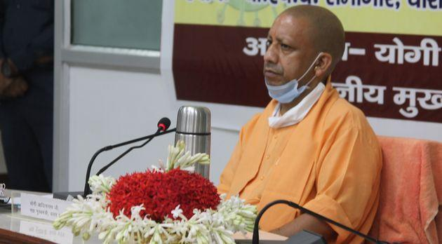 Uttar Pradesh Chief Minister Yogi Adityanath during a Covid-19 review meeting at BHU's central office on July 26, 2020 in Varanasi.