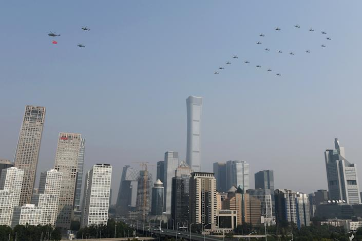 """Military helicopters fly over the Central Business District in the formation of the number """"70"""" during the military parade marking the 70th founding anniversary of People's Republic of China, on its National Day in Beijing, China October 1, 2019. (Photo: Stringer/Reuters)"""