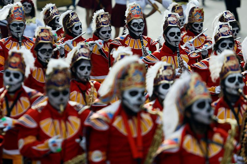 Masked musicians participate in a procession to commemorate Day of the Dead in Mexico City on Saturday.