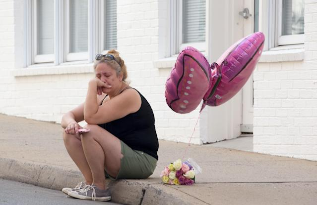 <p>A woman mourns at the corner of Fourth Street and Water Street, where a car plughed into a crowd of people at a rally, Charlottesville, Virginia, USA, 13 August 2017. According to media reports at least one person was killed and 19 injured after the car hit a crowd of people counter-protesting the 'Unite the Right' rally which was scheduled to take place in Charlottesville on 12 August. At least 15 others were injured in clashes during protests. (Tasos Katopodis/EPA/REX/Shutterstock) </p>