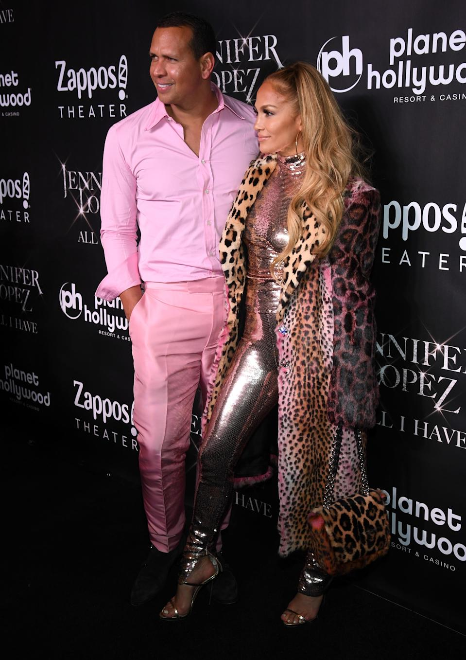 A-Rod stands out in an all-pink suit next to girlfriend J.Lo. (Photo: Getty Images)