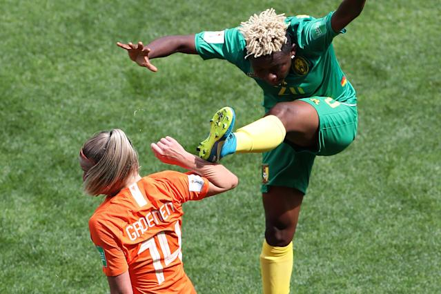 Cameroon's Ngo Mbeleck mounted this dangerous challenge in the vicinity of the Netherlands' Jackie Groenen. (Getty)