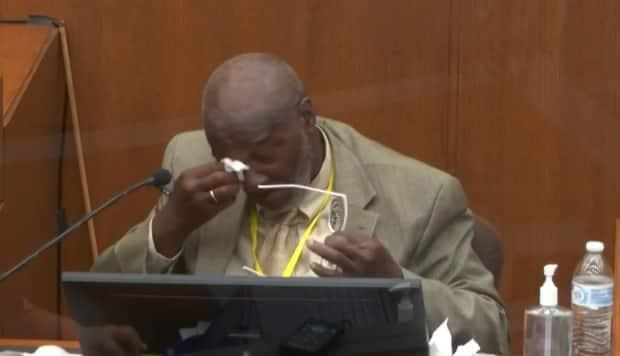 In this image from video, witness Charles McMillian becomes emotional as he answers questions in the trial of former Minneapolis police Officer Derek Chauvin at the Hennepin County Courthouse in Minneapolis, Minn.