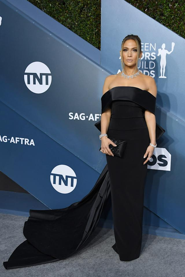 Lopez channeled old Hollywood in an off-the-shoulder black gown with a dramatic train by Georges Hobeika, combined with sparkling Harry Winston jewels.