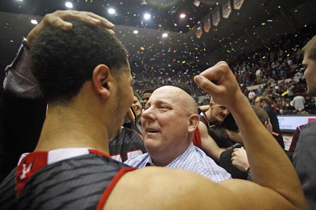 Eastern Washington Head Coach Jim Hayford hugs senior guard and leading scorer in the nation Tyler Harvey (1) after defeating Montana during an NCAA college basketball championship game in the Championship of Big Sky Conference tournament in Missoula, Mont., Saturday, March 14, 2015. (AP Photos/Michael Albans)