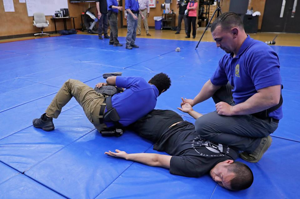 Demonstrating takedown and restraint techniques at a police training facility in Burien, Wash., in 2020.