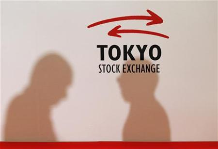 Visitors cast their shadows prior to a ceremony marking the end of trading in 2012 at the Tokyo Stock Exchange