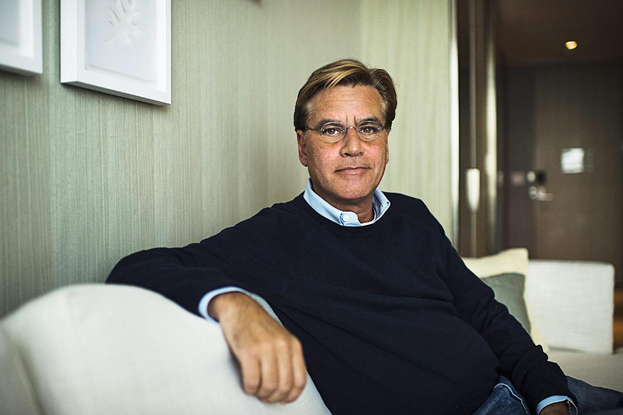 """FILE - In this Oct. 20, 2015 file photo, screenwriter Aaron Sorkin poses for a photo while promoting his movie """"Steve Jobs,"""" in Toronto. Harper Lee's classic novel """"To Kill a Mockingbird"""" - and it's classic hero Atticus Finch - are heading to Broadway in a new adaptation written by Sorkin. Producer Scott Rudin said the play will make it for the 2017-2018 season, under the direction of Tony Award winner Bartlett Sher, who is represented on Broadway now with """"The King and I"""" and """"Fiddler on the Roof."""" (Aaron Vincent Elkaim/The Canadian Press via AP, File)"""