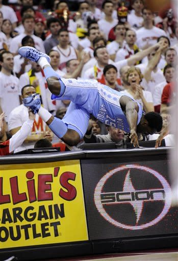 North Carolina guard P.J. Hairston (15) tumbles over the scorers table during the first half of an NCAA college basketball game against Maryland, Wednesday, March 6, 2013, in College Park, Md. (AP Photo/Nick Wass)