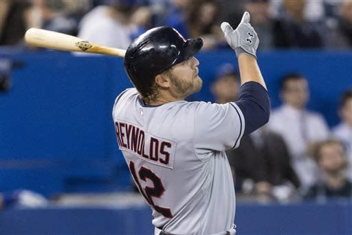 Cleveland Indians' Mark Reynolds hits a solo homer off Toronto Blue Jays pitcher Sergio Santos during 11th inning of a baseball game to win 3-2 in Toronto on Wednesday, April 3, 2013. (AP Photo/The Canadian Press, Chris Young