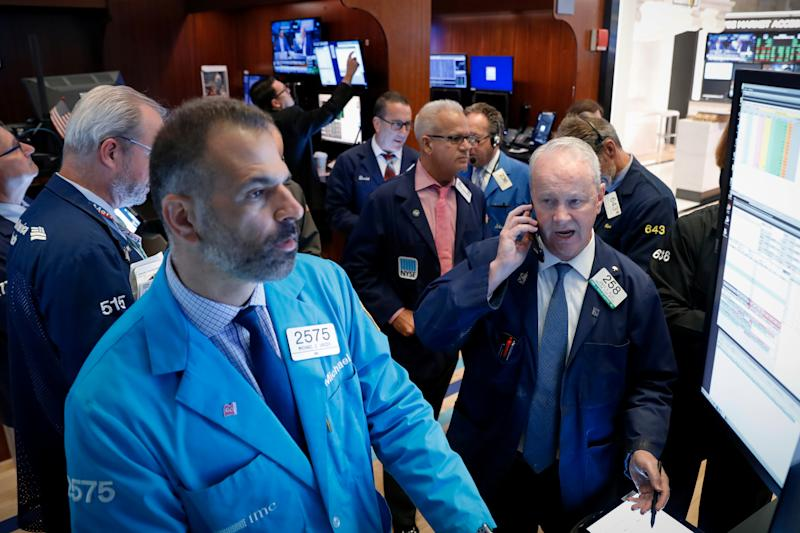 Traders work on the floor at the New York Stock Exchange (NYSE) in New York, U.S., September 5, 2019. REUTERS/Brendan McDermid