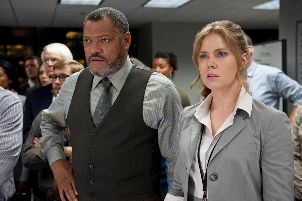 """This film publicity image released by Warner Bros. Pictures shows Laurence Fishburne as Perry White, left, and Amy Adams as Lois Lane in """"Man of Steel."""" (AP Photo/Warner Bros. Pictures, Clay Enos)"""