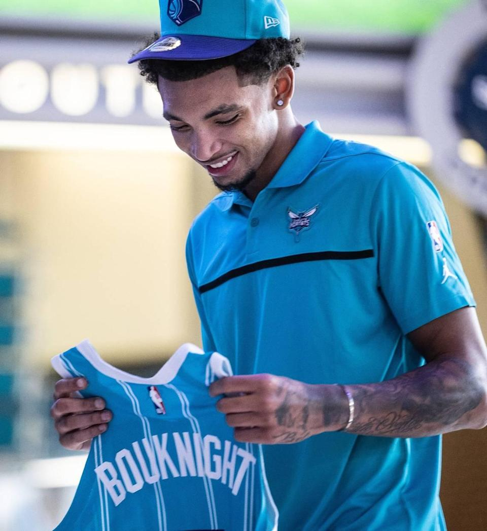 Charlotte Hornets draft pick James Bouknight holds his new jersey during a press conference at the Spectrum Center in Charlotte, N.C., on Friday, July 30, 2021.