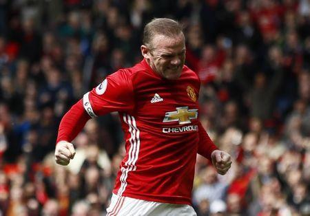 Britain Football Soccer - Manchester United v Swansea City - Premier League - Old Trafford - 30/4/17 Manchester United's Wayne Rooney celebrates scoring their first goal Action Images via Reuters / Jason Cairnduff Livepic