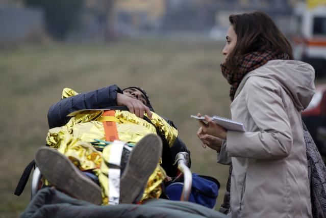 <p>A passenger on a stretcher talks to a woman after being rescued from a derailed train, in Pioltello Limito, on the outskirts of Milan, Italy, Thursday, Jan. 25, 2018. (Photo: Luca Bruno/AP) </p>