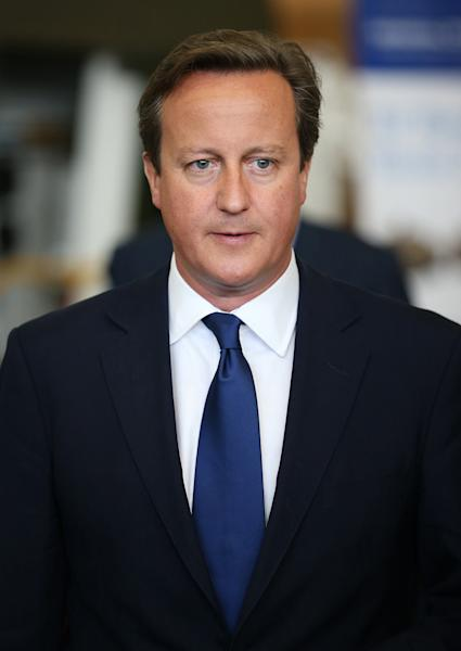 British Prime Minister David Cameron visits the British arm of US defence company General Dynamics on September 3, 2014, in Blackwood, Wales (AFP Photo/Peter Macdiarmid)