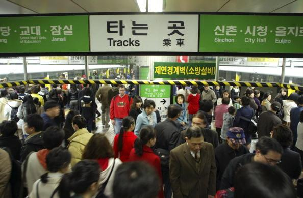 SEOUL, SOUTH KOREA - MARCH 4:  Pedestrians are seen at the subway station on March 4, 2006 in Seoul, South Korea. Seoul has a population of 10,297,004 as of the end of 2005. This accounts for about a quarter of the total national population. The number of foreign residents in Seoul as of the end of 2005 is 129,660 or about 1.3 % of Seoul's total population. They include 77,881 Chinese, 11,487 Americans, and 6,710 Japanese. There are people of more than 90 different nationalities currently residing in Seoul, forming a small global village.  (Photo by Chung Sung-Jun/Getty Images)