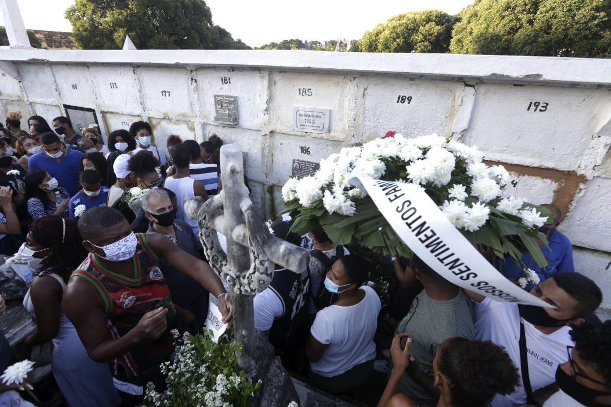 Family and friends attend the funeral of Kathlen Romeu, a young pregnant woman killed by a stray bullet, in Rio de Janeiro, Brazil, Wednesday, June 9, 2021. Stray bullets have struck at least six pregnant women in Rio since 2017, but Romeu was the first to die, according to Crossfire, a non-governmental data project that tracks armed violence. (AP Photo/Bruna Prado)