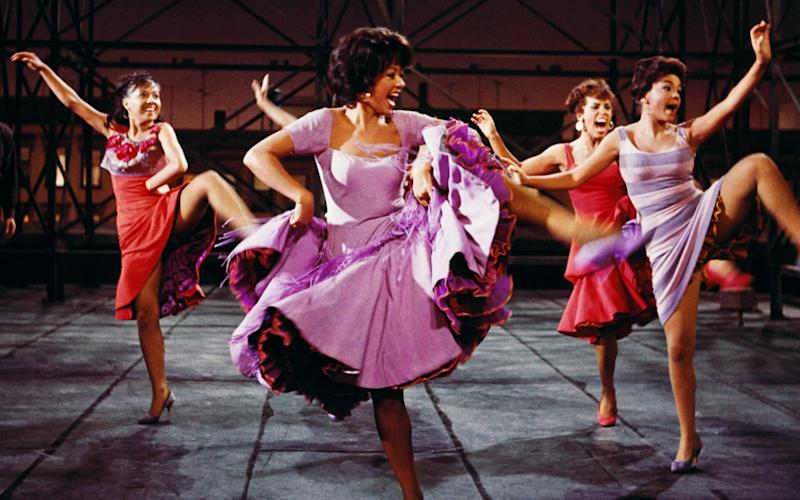 Rita Moreno, Puerto Rican actress, singer and dancer, wearing a short-sleeved lilac dress, dancing in a publicity image issued for the film adaptation of 'West Side Story', USA, 1961. The film musical, starring Moreno as Anita, is adapted from the stage production with music by Leonard Bernstein and Stephen Sondheim. (Photo by Silver Screen Collection/Getty Images) - Silver Screen/Getty Images