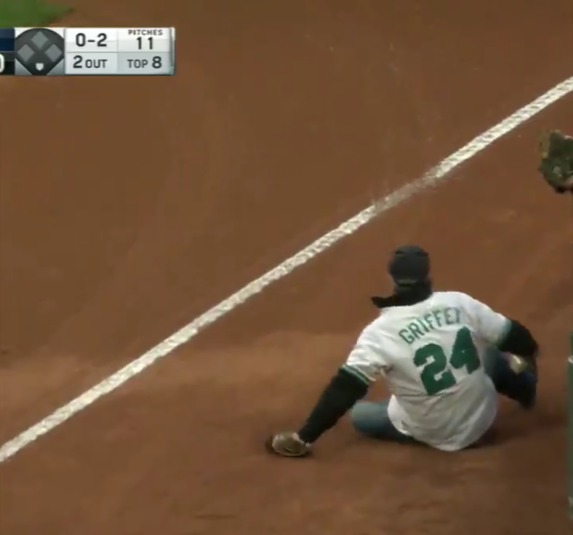 A Seattle Mariners fan fell onto the field Wednesday at AT&T Park while trying to catch a foul ball. (MLB/screen grab)