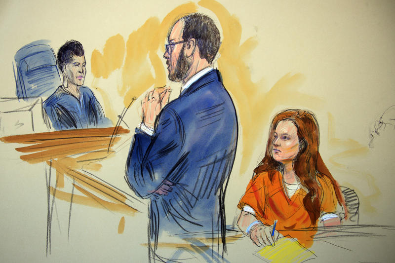 This courtroom sketch depicts Maria Butina, a 29-year-old gun-rights activist suspected of being a covert Russian agent, listening to Assistant U.S. Attorney Erik Kenerson as he speaks to Judge Deborah Robinson, left, during a hearing in federal court in Washington, Wednesday, July 18, 2018. Prosecutors say Butina was likely in contact with Kremlin operatives while living in the United States. And prosecutors also are accusing her of using sex and deception to forge influential connections. (Dana Verkouteren via AP)