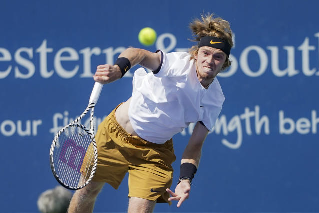 Andrey Rublev, of Russia, serves to Roger Federer, of Switzerland, during the quarterfinals of the Western & Southern Open tennis tournament, Thursday, Aug. 15, 2019, in Mason, Ohio. (AP Photo/John Minchillo)
