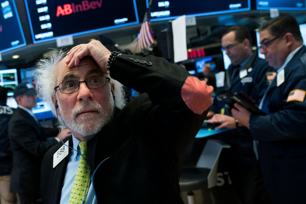 <p>Traders and financial professionals work on the floor of the New York Stock Exchange (NYSE) at the closing bell, Feb. 2, 2018 in New York City. The Dow dropped 250 points at the open on Friday morning. The Dow plunged over 660 points on Friday, marking its biggest one-day plunge since June 2016 following the Brexit vote. Photo from Drew Angerer/Getty Images. </p>